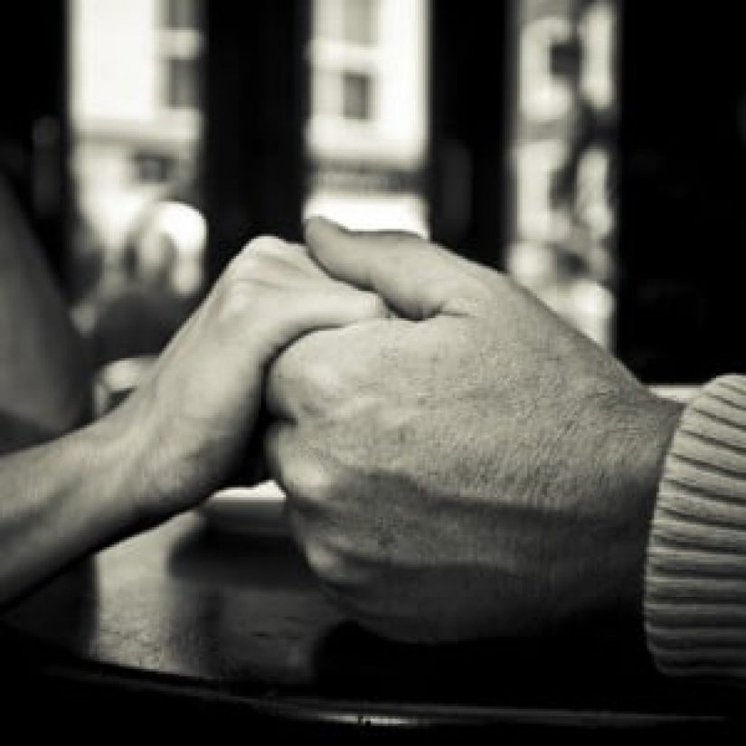 photo of people holding hands